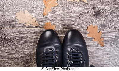 Blue boots on the ground - Mens shoes for autumn on rustic...