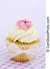 Pink and white cupcake - Cupcake decorated with a pink sugar...