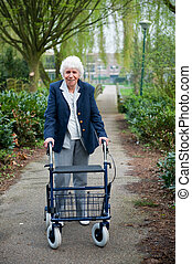 Elderly woman with walker - Very old lady with blue walker...