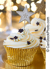 New Year celebration cupcakes - Golden cupcakes against a...