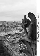 Gargoyle overlooking Paris - Gargoyle on Notre Dame...