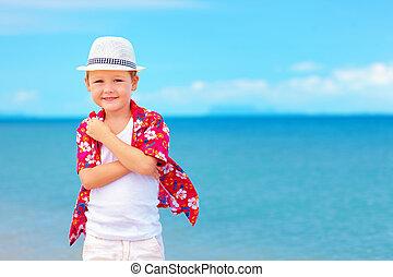 portrait of cute boy kid on summer vacation