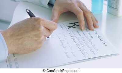 Doctors hand writting rx prescription - Doctors hand...