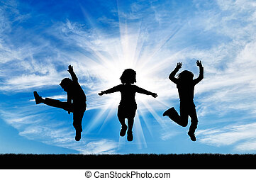 Silhouette happy children jumping