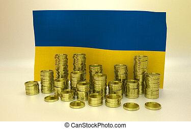 Golden coins and Ukrainian flag - money concept