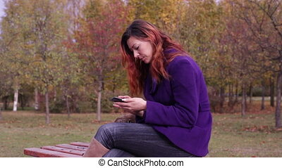 Woman looking information in a smartphone