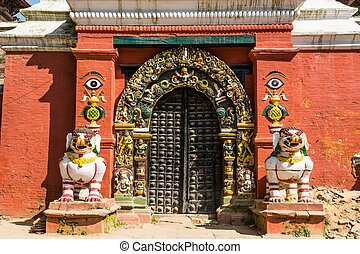 Temple gate guarded by deities. Budist monastery at Durbar...
