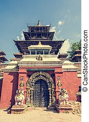 Temple gate guarded by deities Entrance to a monastery at...