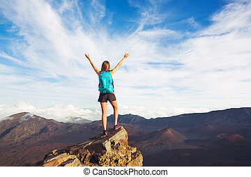 Young Woman with Backpack on Mountain Peak with Open Arms -...
