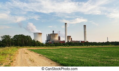 Coal Power Station And Dirt Road - Dirt road on a hill...