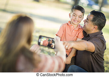 Mixed Race Family Taking A Phone Camera Picture