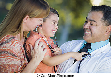 Mixed Race Boy, Mother and Doctor Having Fun With...
