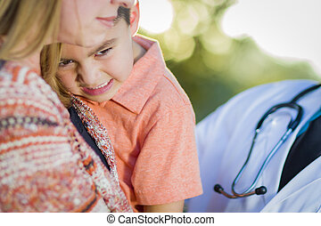 Sick Mixed Race Boy, Mother and Hispanic Doctor Outdoors -...