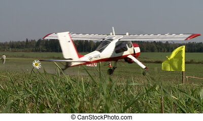 Airfield in summer. Single-engine plane on runway - Airfield...