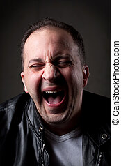 Surprised Man - A man laughing hysterically at something...