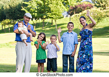 Happy Waving Family - Portrait of an attractive young family...