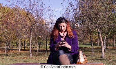 Woman taking a photo on smartphone - A young woman taking a...