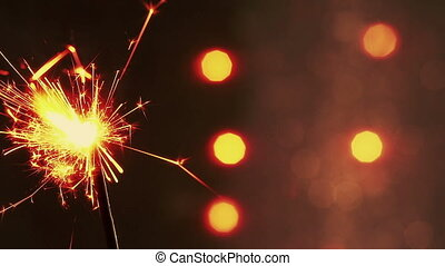 firework sparkler burning on bokeh light background,...