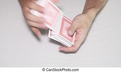 Shuffling playing cards on white background - Shuffling...