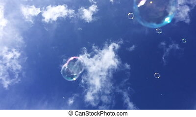 Soap bubbles fly against the sky Freedom and day dream...