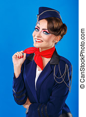 Stewardess with face art corrects neckerchief. Young...