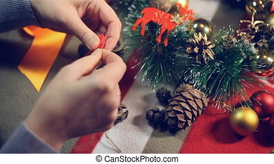 tying the knot on a bow - Preparing for Christmas , a master...
