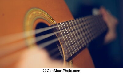 Twitching string guitar - Video macroshot of the game on an...