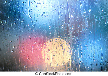 Drops Of Rain On Blue Glass Background. Street Bokeh Lights...