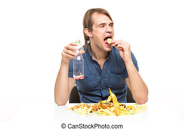 male slut drinking soda and eating chips. desk cesspool....