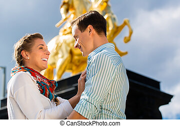 Couple in Dresden with Goldener Reiter statue