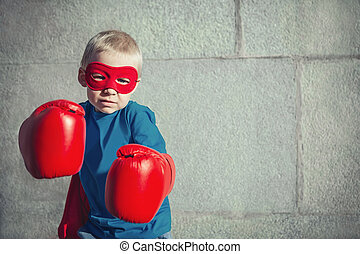 Fighting - Little boy with boxing gloves