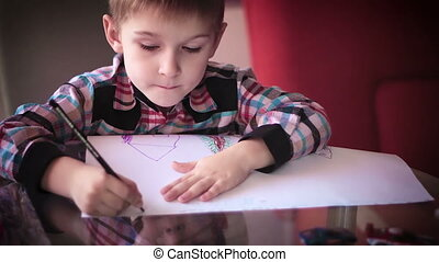 Little boy sitting at table and drawing9