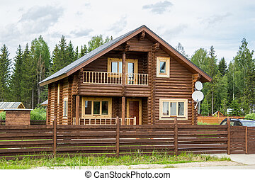 brown wooden house behind wooden fence - brown wooden house...