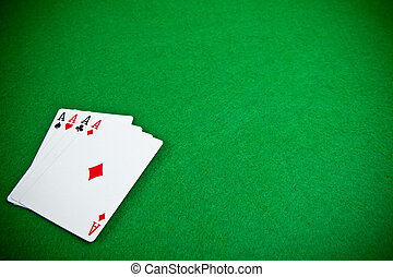 Four aces at the poker table