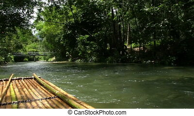 Rafting On A Bamboo Raft - rafting on the tropical river on...