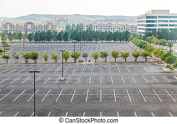 Large Empty Parking Lot with One White Car - Empty parking...