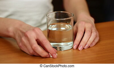 Woman Dissolving Effervescent Table - Dissolving...
