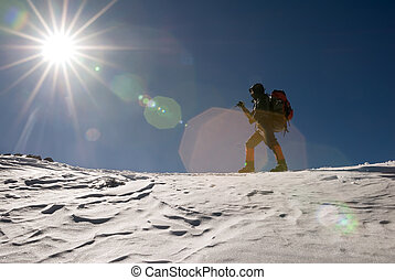 mountain climber - Man of mountain climber walk in snow...