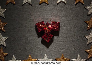 Stack of gift boxes on slate with star frame - Stack of gift...