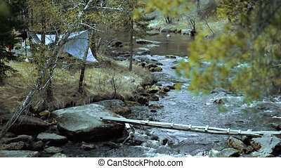 Camp with tourists on the shore of a mountain river - Bridge...