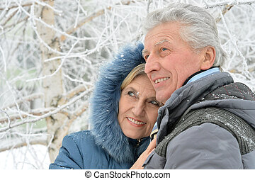 senior couple at winter outdoors - Portrait of a happy...
