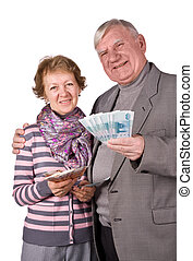Elderly married couple with money in hands