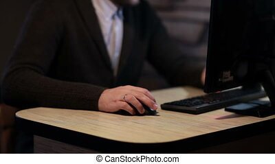 Man working on computer in the workplace - Businessman...