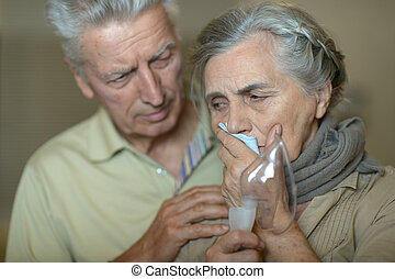 woman with flu inhalation - Portrait of elderly man and...