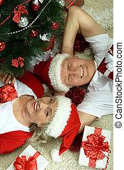 Elderly couple celebrating new year - Happy beautiful...