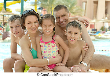 Family having fun near pool