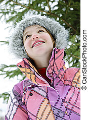 Happy young girl in winter jacket