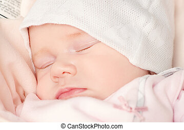 innocence - Sweet little newborn baby sleeping in her bed
