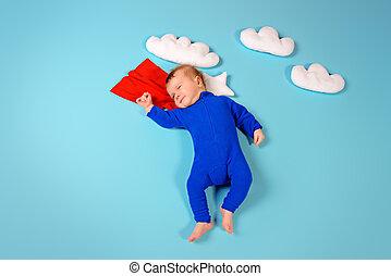 super kid - Newborn baby Little super hero flying through...