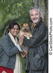 Happy couple with their dog - Portrait of a couple with...